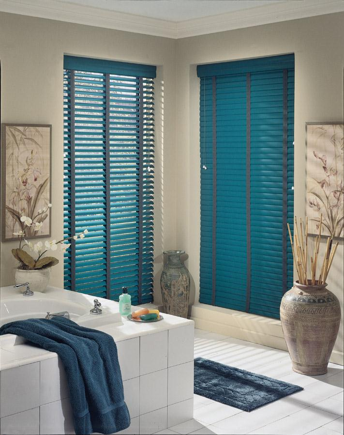 bathroom with two windows - white floor tile - blue blinds